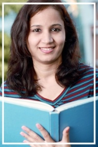 Smiling Indian female student holding books-405332-edited.jpg