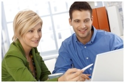 teaching qualification, working together, discussing work, using computer, smiling-250398-edited.jpg