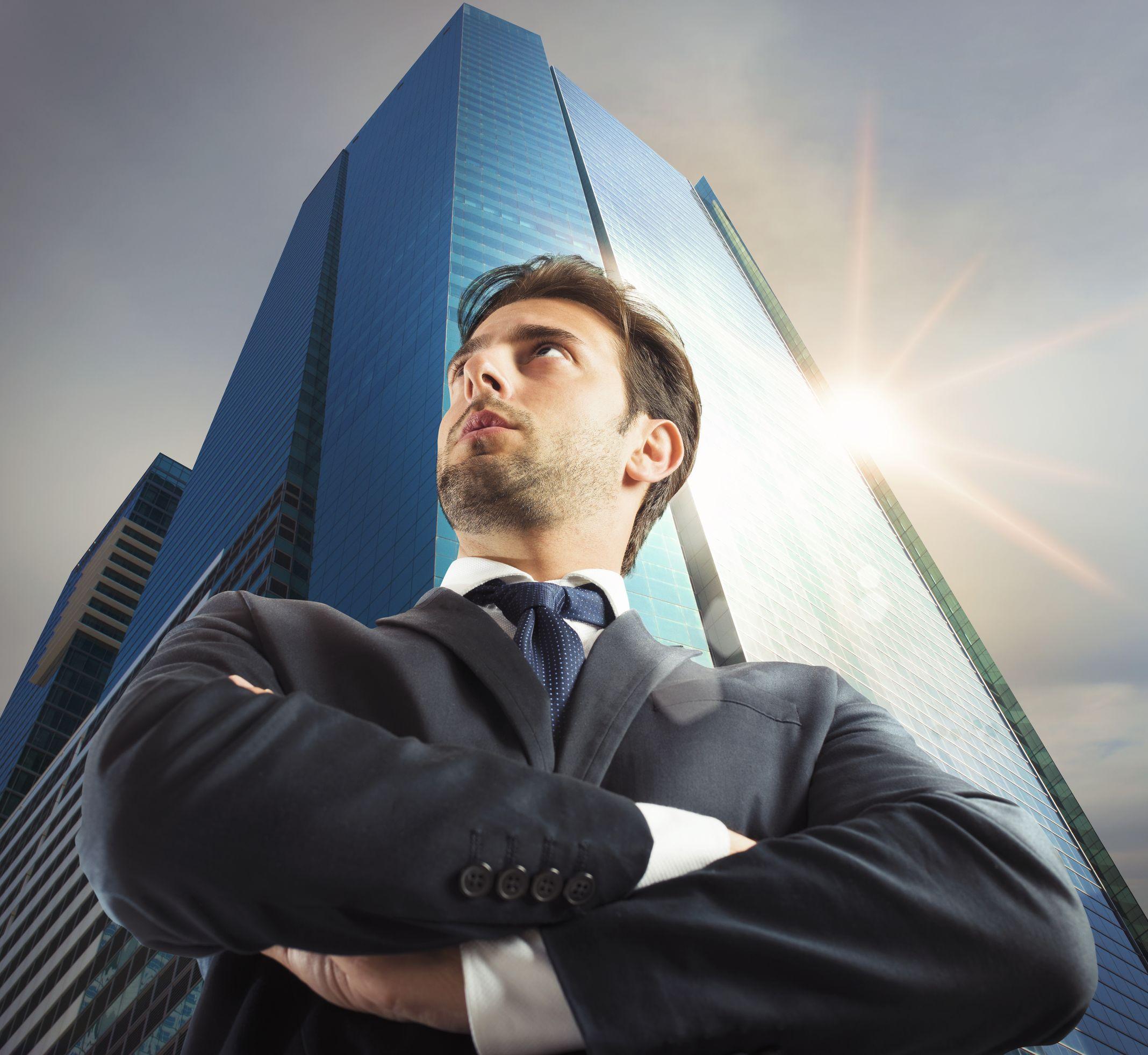 Successful_businessman_with_skyscraper_in_the_background.jpg